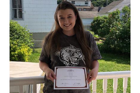 Jacqueline Sharp holds certificate