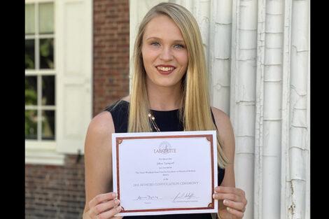 Jillian Updegraff holds certificate