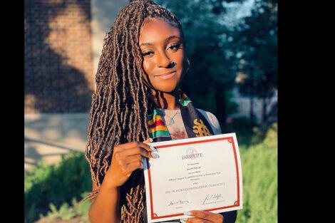Josette Yeboah holds certificate