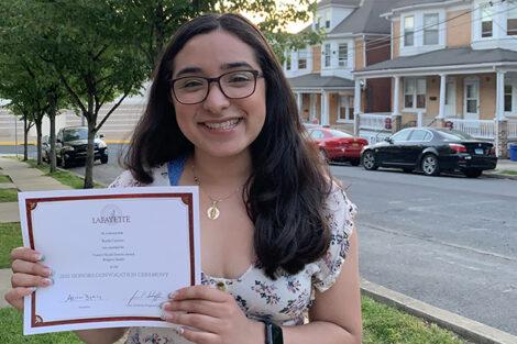 Karla Carino holds certificate