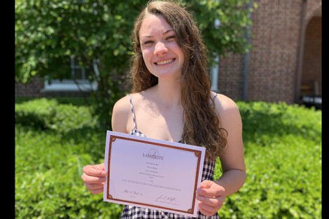 Katie Rice holds certificate