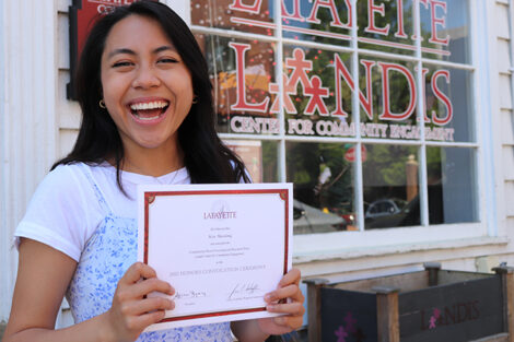 Kimberly Mae Manalang holds certificate