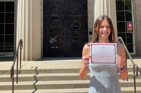 Krystyna Keller holds certificate