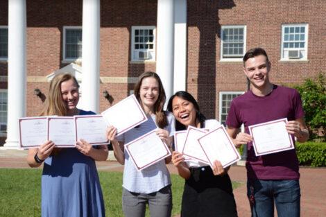 Lauren Philips Jackson, Katie Kavanagh, Kimberly Mae Manalang, Austin Best hold certificates