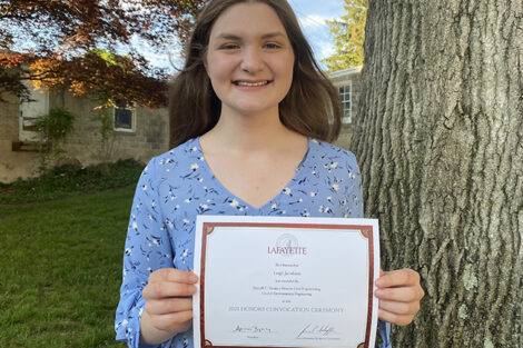 Leigh Jacobsen holds certificate