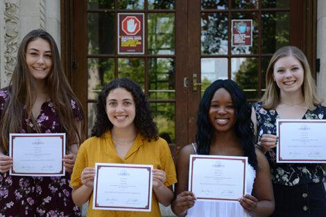 Rachel Cox, Carly Jones, Thalia Charles, Luisa Gunn hold certificates