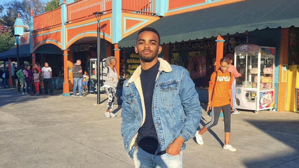 Mario Sanchez Castillo '21 stands outside in a jean jacket