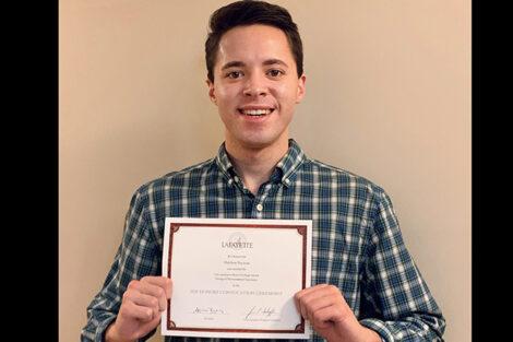 Matthew Tascione holds certificate
