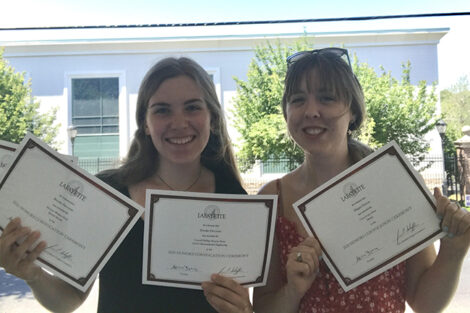 Megan Deacon and Brooke Paccione hold certificates