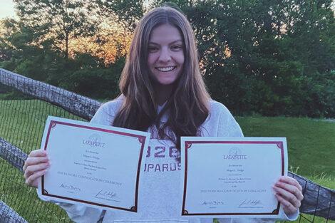 Megan Dodge holds certificates