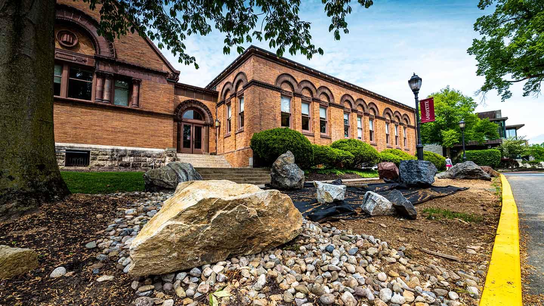 large rocks sit outside Van Wickle Hall