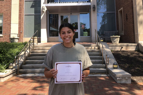 Ruthie Wilson holds certificate