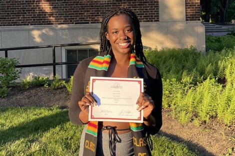 Savanna Toure holds certificate