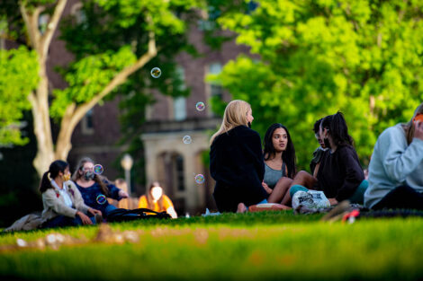 Students sit on the Quad before Jerry Greenfield speaks.