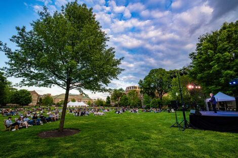 Students sit on blankets on the Quad as Jerry Greenfield speaks.