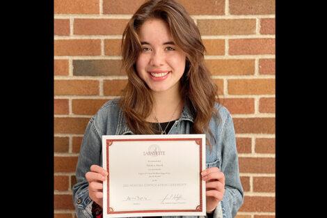 Shiloh Harrill holds certificate