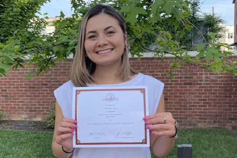 Theresa Chua holds certificate