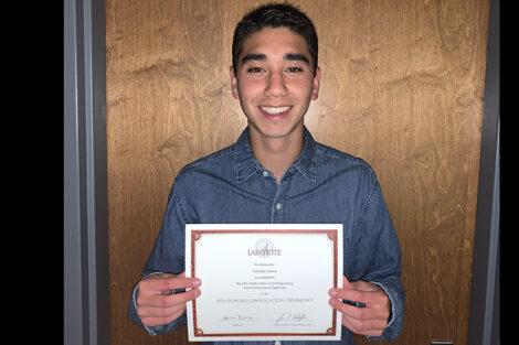 Tim Larsen holds certificate