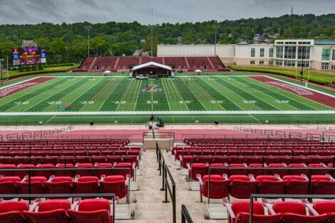 chairs set out on an empty Fisher Field pre-Commencement