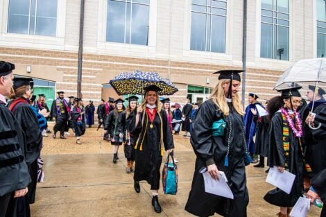 faculty smile as seniors walk toward Fisher Field Commencement 2021 8