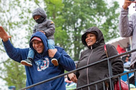 family cheers and waves in Fisher Field stands Commencement 2021