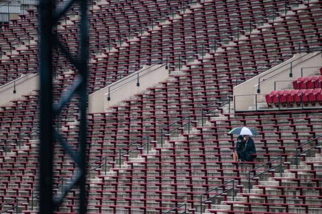 family sits in stands Commencement 2021