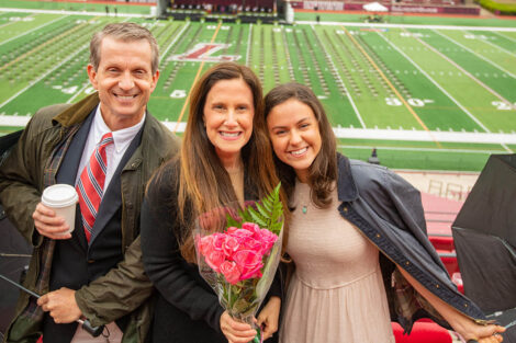 family smiles from the stands Fisher Field Commencement 2021