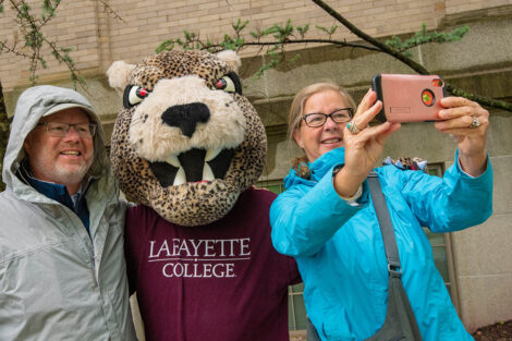 parents take a selfie with the Leopard