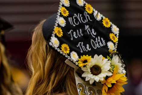 senior's cap decorated never tell me the odds