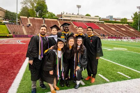 seniors smile on Fisher Field Commencement 2021