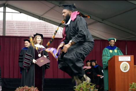 student celebrates on stage with a dance Commencement 2021