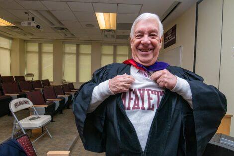 trustee wears Lafayette sweatshirt under gown