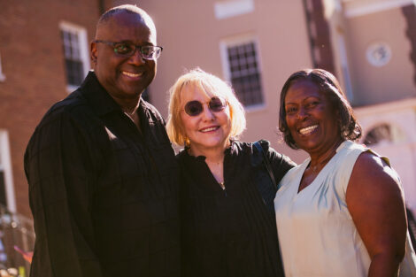 Professor Ian Smith and his sister congratulate Patricia Donahue