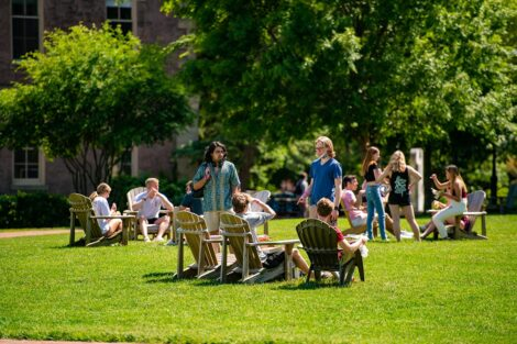 Many students in groups on the Quad.