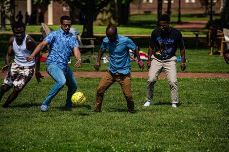 Students play soccer on the grassy Quad.
