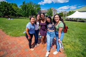 Students smile together on the Quad.