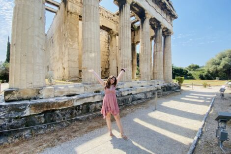 A Study Abroad student poses in front of the Parthenon in Greece, Summer 2021