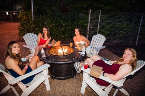 Students sit around a fire pit at Last Night celebration.