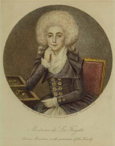 Image of Madame Lafayette sitting at a desk from the college archives