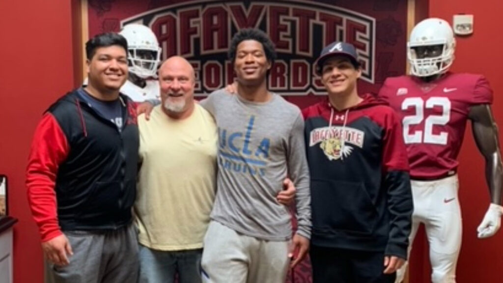 Matt Bayly and Kaizer Butler and Butler's brothers smile together