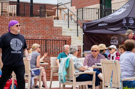 customers at Trolley Stop eat at tables outside