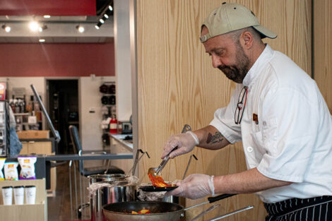chef serves food at Trolley Stop open house