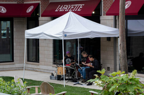 musicians play under a tent at Trolley Stop open house