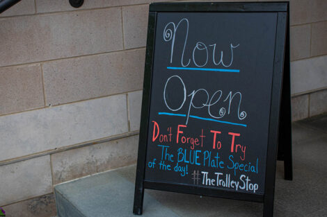 now open sign outside Trolley Stop