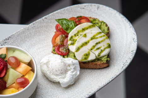 Trolley Stop's avocado toast with fruit and poached egg