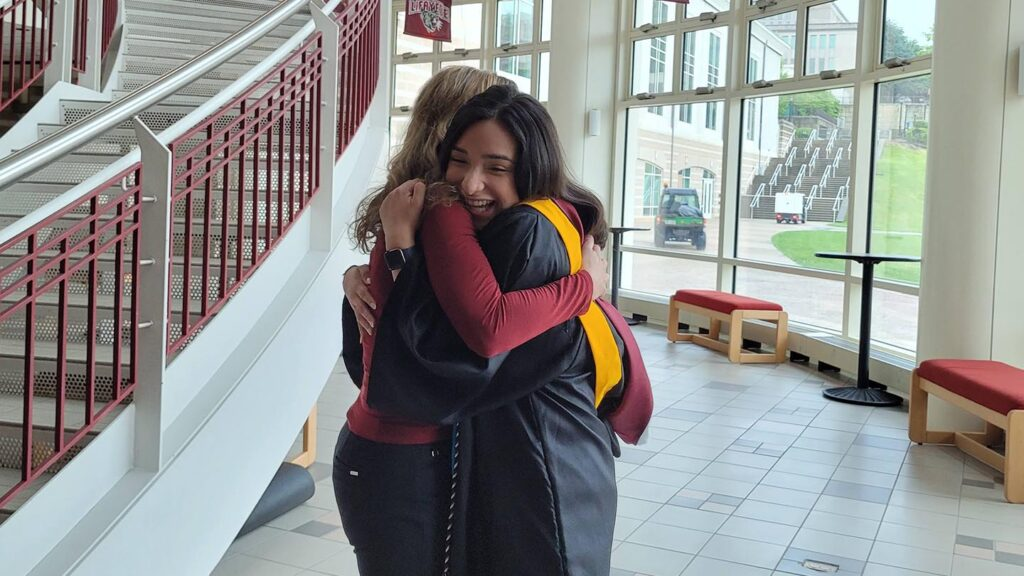 Lisa Gabel hugs Karla Cariño