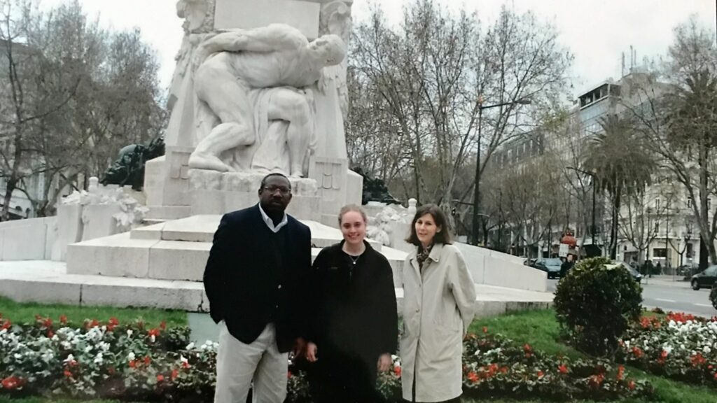"""Emily Fogelberg Anthony '05 (center) with Profs. Gladstone """"Fluney"""" Hutchinson and Ute Schumacher presenting research at Atlantic Economic Conference in Lisbon, Portugal, in 2004."""