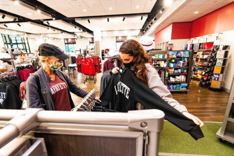 student shops in Lafayette College store with parent