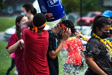 A Lafayette students gets a bucket of water dumped on their head.