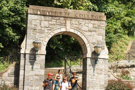 Students walk underneath an archway, heading toward downtown Easton.